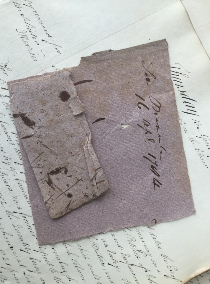 Brown blotting paper with ink stains shown against a manuscript.