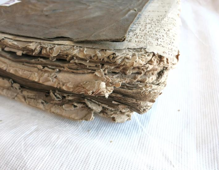 Detail of corner of the book before restoration