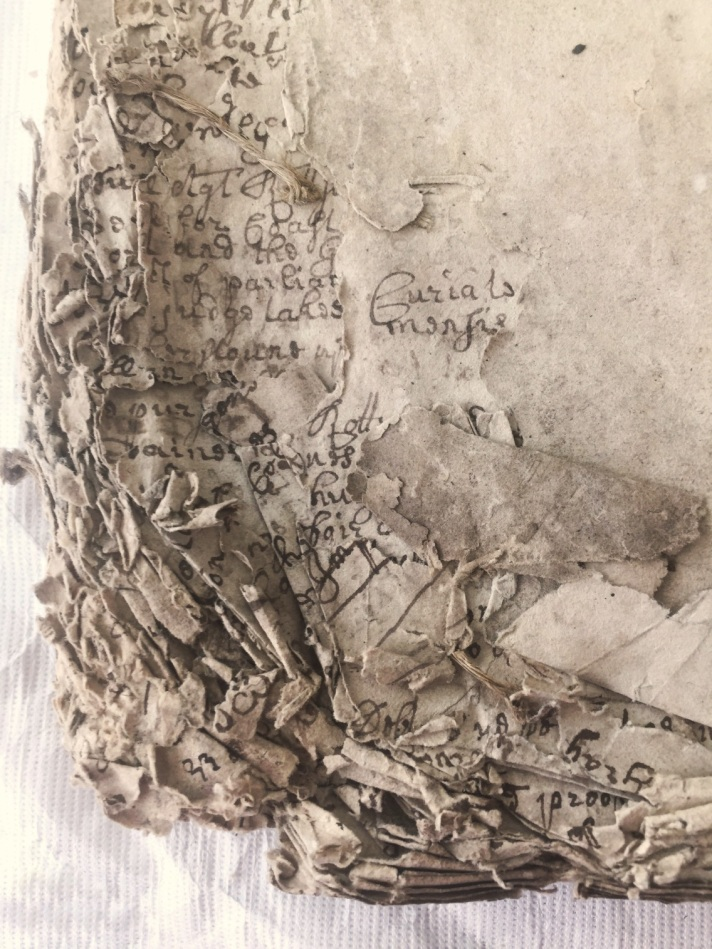 Tattered corner of a book, before restoration